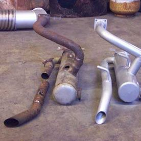 New and old truck exhaust pipes